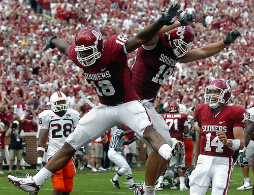 Oklahoma's Jermaine Gresham (18), Joe Jon Finley (19) and Sam Bradford (14) celebrate an Oklahoma touchdown against Miami on Saturday, Sept. 8, 2007, in Norman, Okla. Oklahoma won 51-13. (AP Photo/Enid News & Eagle, Billy Hefton)